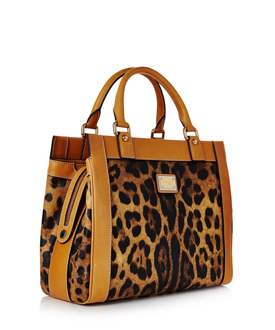 Shop leopard print bag at Neiman Marcus, where you will find free shipping on the latest in fashion from top designers.